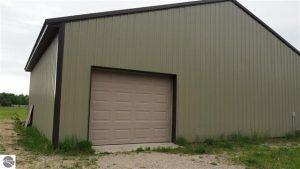 40x32 hangar building with door opener, garage door and service entry.